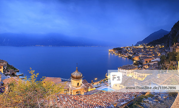 Panorama of Lake Garda and the typical town Limone Sul Garda at dusk  province of Brescia  Italian Lakes  Lombardy  Italy  Europe