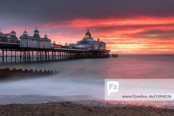Eastbourne Pier against fiery red sky at sunrise  Eastbourne  East Sussex  England  United Kingdom  Europe