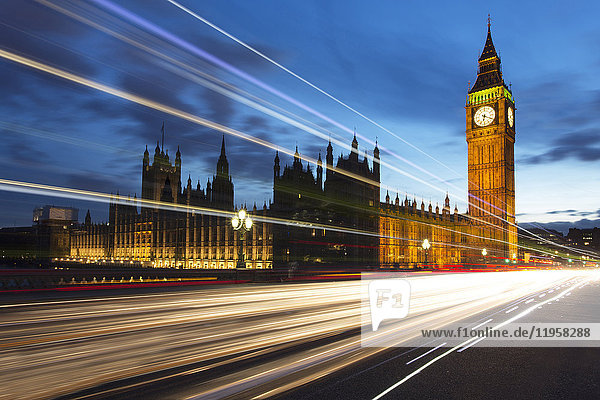 Big Ben and The Houses of Parliament at night with traffic trails on Westminster Bridge  London  England  United Kingdom  Europe