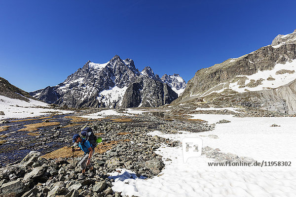 Hiker on a mountain trail  Barre des Ecrins  Ecrins National Park  French Dauphine Alps  Haute Alpes  France  Europe