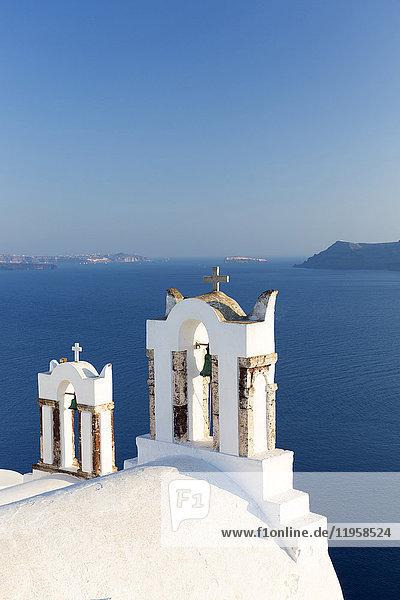 White church belltowers overlooking the Caldera  Oia  Santorini  Cyclades  Greek Islands  Greece  Europe
