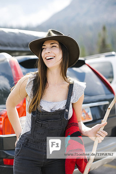 Outdoor portrait of smiling woman wearing hat