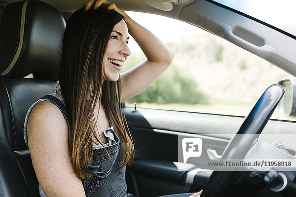 Smiling woman driving car