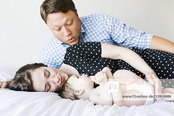 Baby girl (6-11 Months) spending time with parents