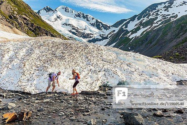Couple hiking at Byron Glacier  Portage Valley  Chugach National Forest  Alaska.