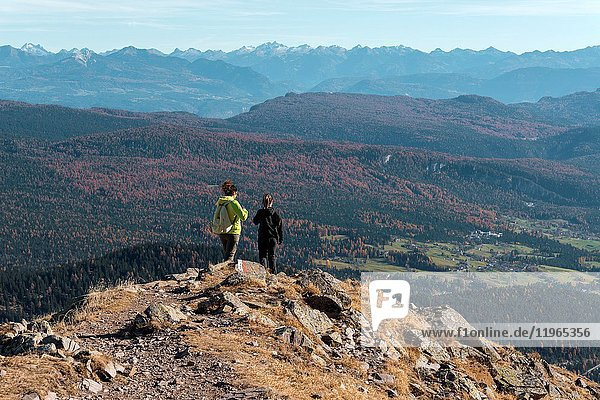 Italy  Trentino Alto Adige  Non valley  two women hikers descend from the top of Luco Mount.