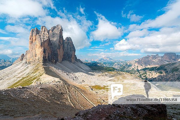 Europe  Italy  Dolomites  Veneto  Belluno. Woman hiker admire Tre Cime di Lavaredo from Trenches of the First World War on Mount Paterno.