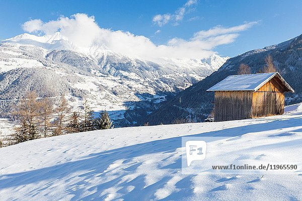 A typical Tyrolean hut overlooks the snow-covered Kaunertal. Ladis  Inntal  Tirol  Osterreich  Europe.