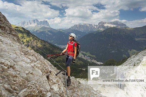 A climber looking the Panorama during a via ferrata  Trento province  Trentino Alto Adige. Italy .