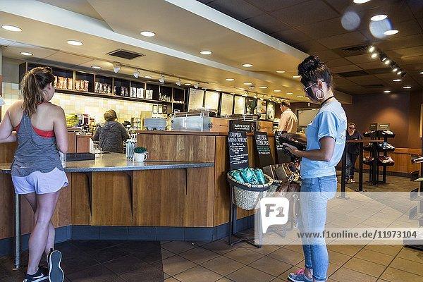 Georgia  St. Simons Island  Starbucks  coffee  coffeehouse chain  inside  counter  customer  woman  interior