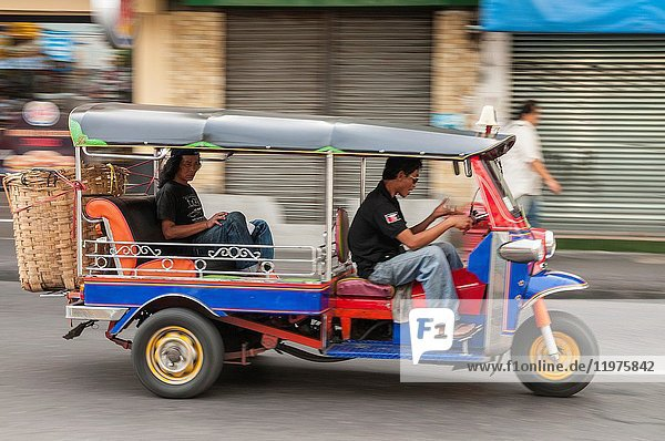 Tuktuk taxi on the road in the Banglamphu district of Bangkok  Thailand.