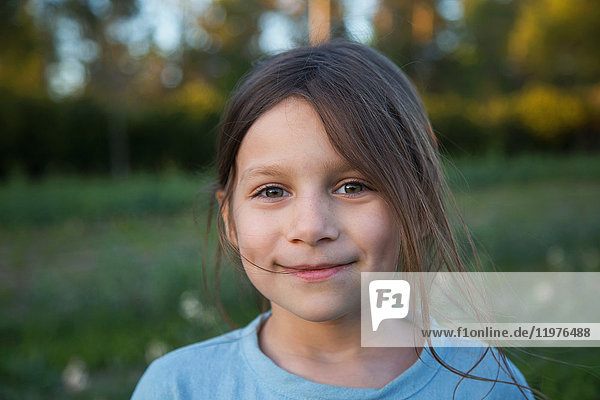 Portrait of young girl  outdoors  smiling  close-up