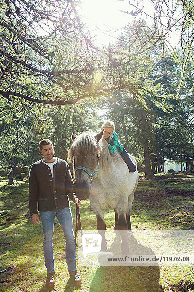 Couple in woodland horse riding  Tirol  Steiermark  Austria  Europe