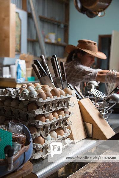 Woman working in farm kitchen