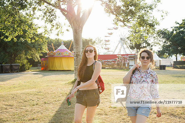 Portrait of two female friends at festival