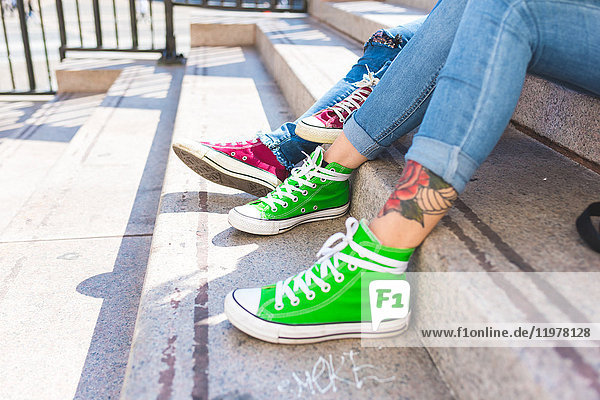 Women's feet in trainers on step  Milan  Italy