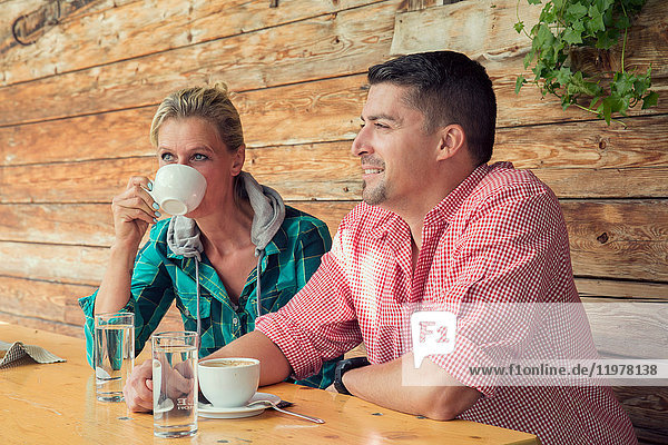 Couple in cafe drinking coffee  Tirol  Steiermark  Austria  Europe