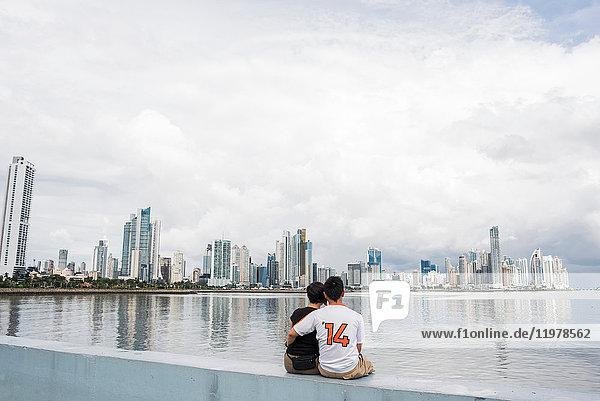 Rear view of couple sitting by water  Panama City  Panama  Panama