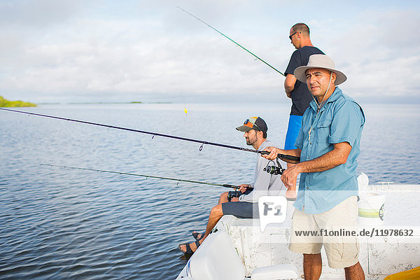 Men fishing in the Gulf of Mexico  Homosassa  Florida  US