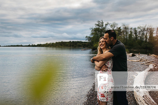 Romantic couple hugging on beach  Oshawa  Canada