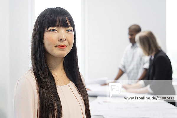 Portrait of brunette young woman in architect office