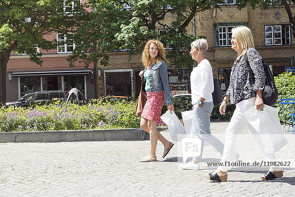 Women on way back from shopping