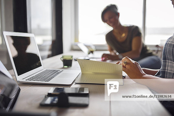 Women sitting at table in office