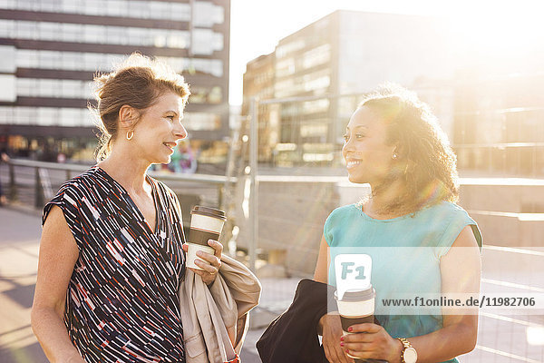 Businesswomen talking and smiling