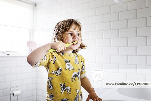 Small girl (2-3) brushing teeth Small girl (2-3) brushing teeth