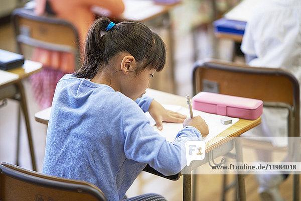 Japanese elementary school kid in the classroom