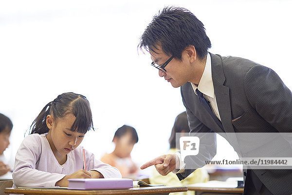 Japanese elementary school teacher teaching in the classroom