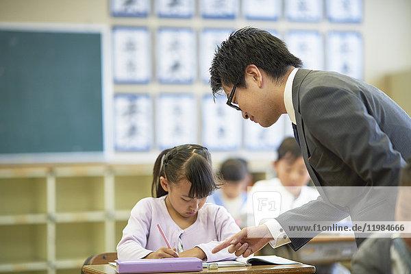 Japanese elementary school teacher teaching in the classroom