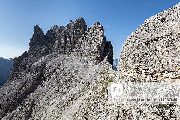 Sesto / Sexten  province of Bolzano  Dolomites  South Tyrol  Italy. Climber on the via ferrata 'Passaporto' at the Mount Paterno.