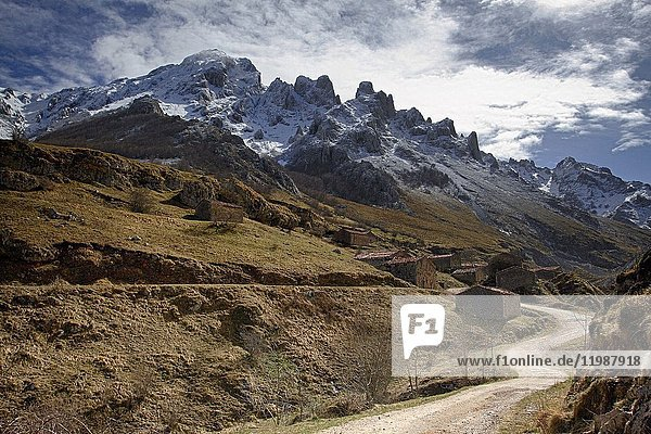 A beautiful road of the village of Vegas del Toro  near Sotres  after a slight late spring snowfall  sotres  bulnes  picos de europa  asturias  spain.