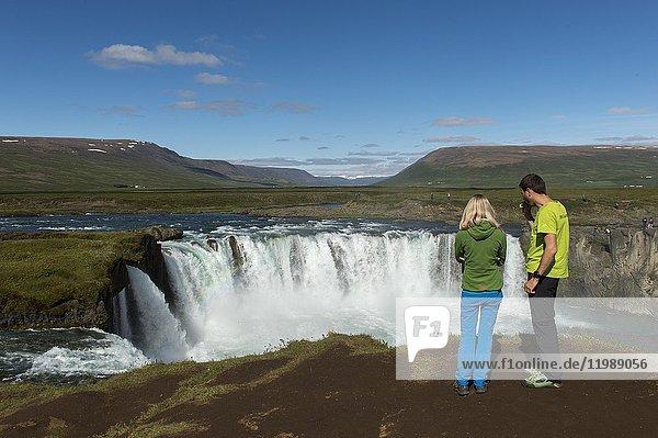People at the the Godafoss waterfall (Skjalfandafljot River) in Northeast Iceland.