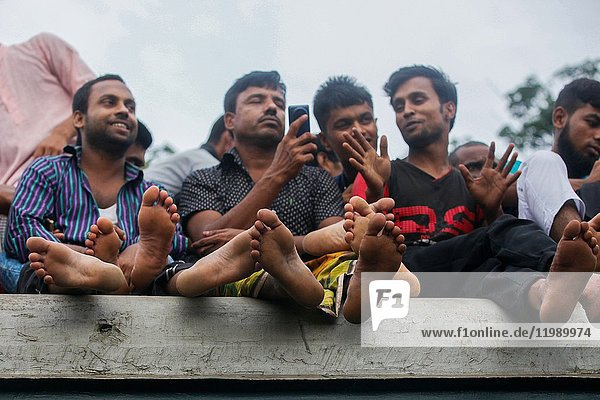 Bangladeshis cram onto a train as they travel home to be with their families ahead of the Muslim festival of Eid al Fitr  in Dhaka. EId-ul-fitr or Eid-ul-Azha is one of the biggest celebrations for Muslims around the world. As a Muslim country Bangladesh also celebrates this. During this celebration Bangladeshi people loves to celebrate this holy celebration with their family members. As people comes to Dhaka for education and job purpose  during the Eid time the rail stations  bus stations and launch terminal get overpopulated for the number of travelers.