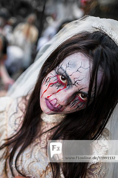 A Salvadoran girl  with blood face paint  performs an indigenous mythology character called La Llorona in the La Calabiuza parade at the Day of the Dead celebration in Tonacatepeque  El Salvador  1 November 2016. The festival  known as La Calabiuza since the 90s of the last century  joins Salvador's pre-Hispanic heritage and the mythological figures (La Sihuanaba  El Cipitío  La Llorona etc. ) collected from the whole Central American region  together with the catholic All Saints Day holiday and its tradition of honoring the dead relatives. Children and youths only  dressed up in scary costumes and carrying painted carts  march from the local cemetery to the downtown plaza where the party culminates with music  dance  drinking and eating pumpkin (Ayote) with honey.