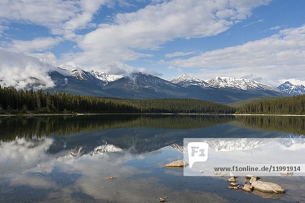 Reflections on the Lake Patricia and the gigantic panorama of the Rocky Mountains  Jasper National Park  Alberta  Canada.