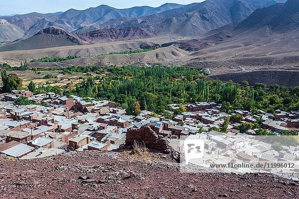 Aerial view from mountain above famous red village Abyaneh in Natanz County  Iran. Sasanian Empire ruins on foreground.