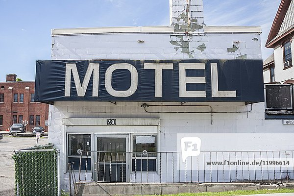 'Motel' sign on an old  abandoned motel.