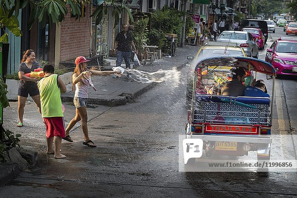 Scenes of sympathetic 'attacks' of blessings with water through the streets of Bangkok during Songkran. Bangkok  Thailand  Asia.