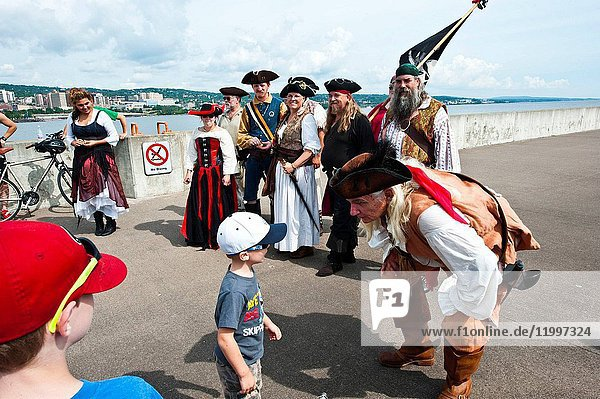Minnesota  Duluth  Tall Ships Festival 2016  Pirate Re-enactors on Ship Canal Pier with tourists