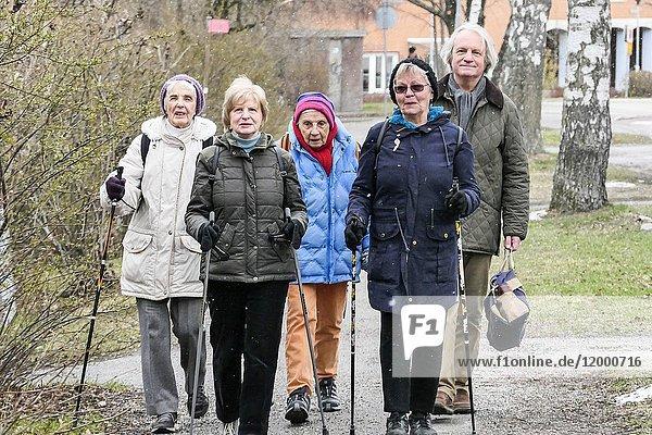STOCKHOLM  SWEDEN Group of elderly retired women walk every Thursday through the neighborhood of Mälarhöjden to church-sponsored soup lunch at the local church.