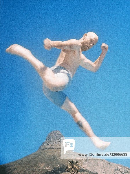 Man Jumping over Mountain