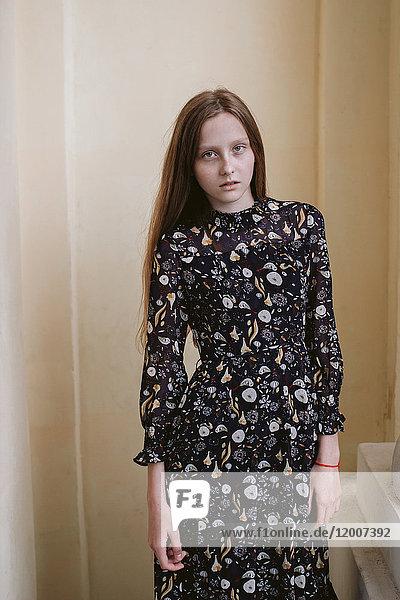 Serious Caucasian woman wearing dress