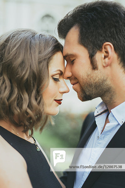 Portrait of smiling Caucasian couple touching faces