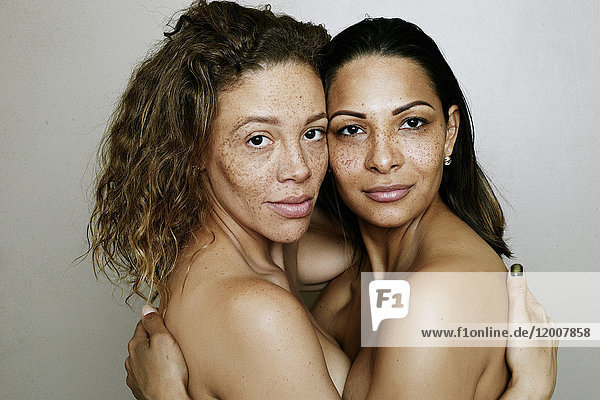 Close up of mixed race women hugging