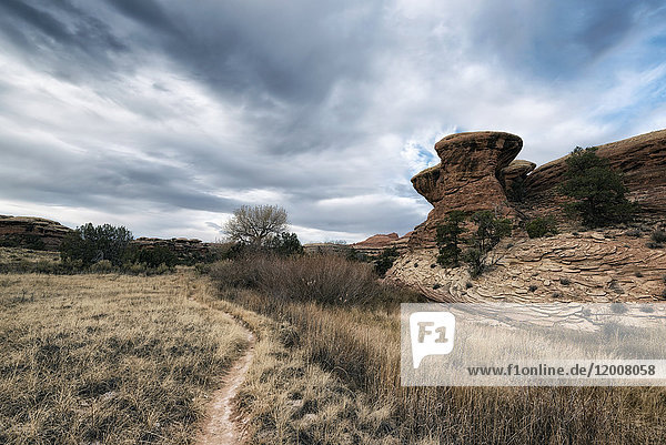 Clouds over desert path  Moab  Utah  United States