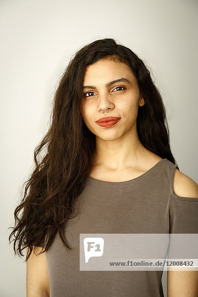Portrait of mixed race woman with nose ring