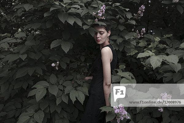 Caucasian woman standing in flowers